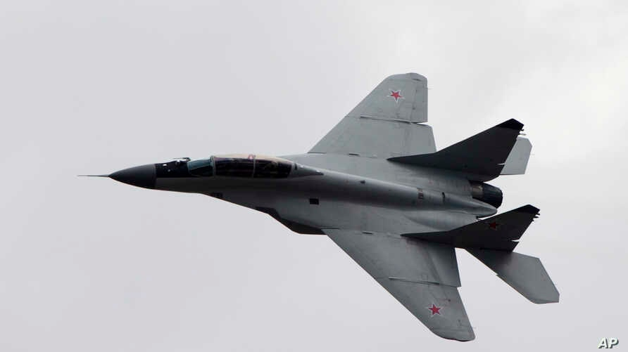 FILE - Russian MIG-29 plane is seen in flight, in Zhukovsky, outside Moscow, Russia, Aug. 11, 2012.