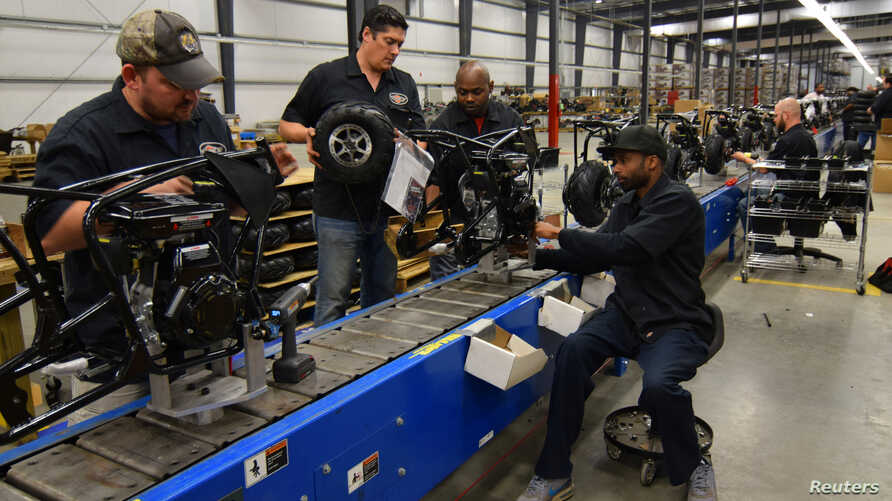 FILE - Workers construct mini-bikes at motorcycle and go-kart maker Monster Moto in Ruston, Louisiana, Jan. 25, 2017.