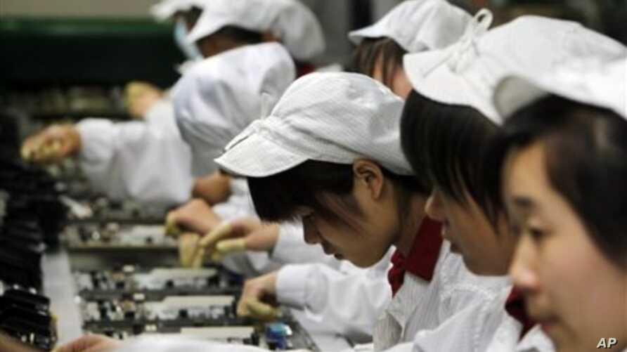 Staff members work on the production line at the Foxconn complex in the southern Chinese city of Shenzhen, Southern city in China, May 26, 2010