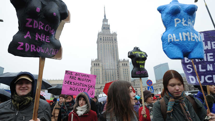 Protesters march demanding greater accessibility of abortion but also for better work conditions and more state support in raising children, Warsaw, Poland, March 6, 2016.