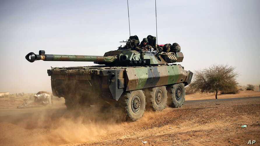 A French tank is seen heading north  at the tail end of a 60-plus military convoy in Gao, northern Mali, February 6, 2013.