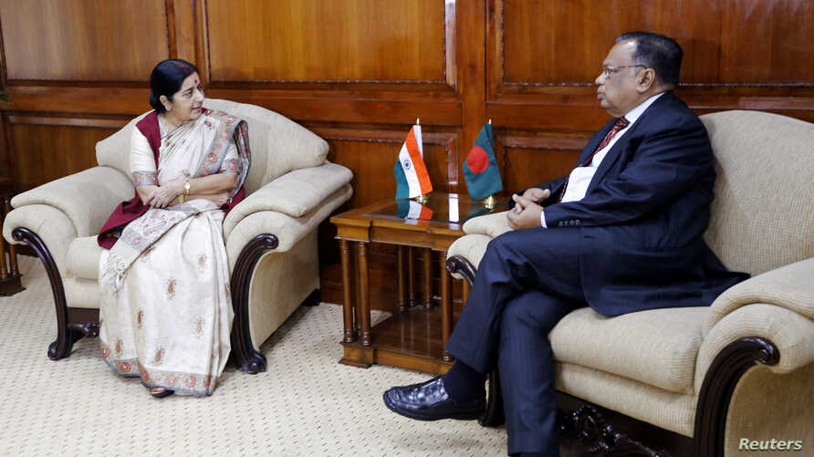 External Affairs Minister of India Sushma Swaraj speaks with her Bangladeshi counterpart Abul Hassan Mahmood Ali at the Ministry of Foreign Affairs, Dhaka, June 26, 2014.