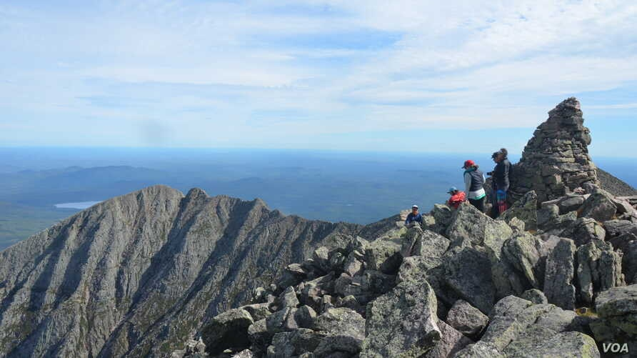 Appalachian Trail hikers end their journey at the top of Mount Katahdin
