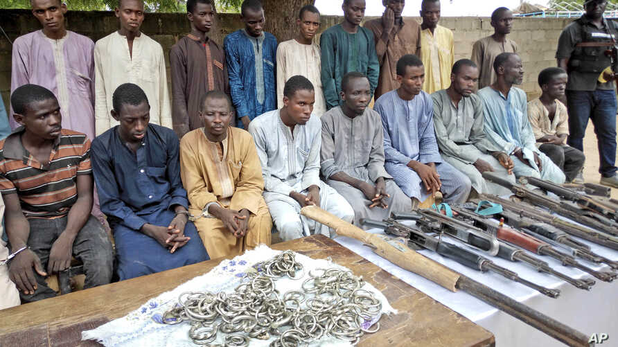 A group of men identified by Nigerian police as Boko Haram extremist fighters and leaders are shown to the media, in Maiduguri, Nigeria, July 18, 2018.
