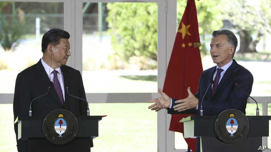 China's President Xi Jinping, left, listens to Argentina's President Mauricio Macri during a joint press conference at the presidential residence in Olivos, a northern suburb of Buenos Aires, Argentina, Dec. 2, 2018.
