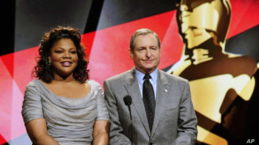 Actress Mo'Nique (L) and Academy of Motion Picture Arts and Sciences President Tom Sherak speak at the 83rd Annual Academy Awards Nominations Announcement in Beverly Hills, California, 25 Jan 2011