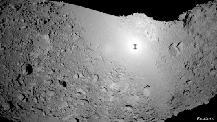 """The 548-meter long asteroid - """"25143 Itokawa"""" - is seen nearly 300 million kilometers from earth in this photo taken November 20, 2005 by the Japanese unmanned Hayabusa."""