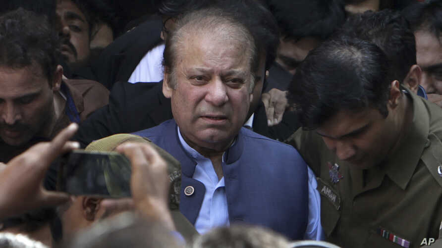 FILE - Former Pakistani prime pinister Nawaz Sharif leaves after appearing in court in Lahore, Pakistan, Oct. 8, 2018.