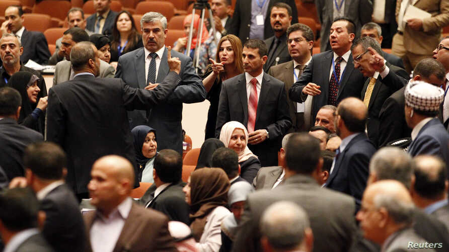 Members of the newly elected Iraqi parliament point fingers at each other after an argument broke out at the parliament headquarters in Baghdad July 1, 2014.