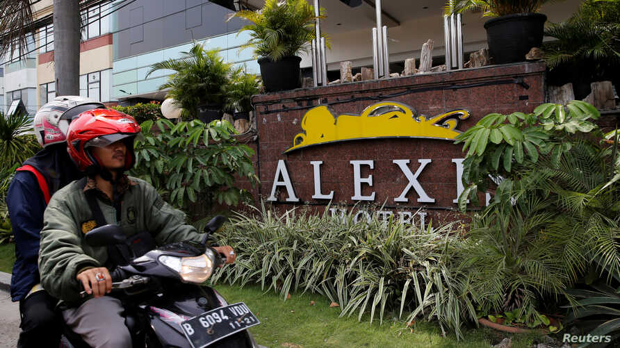 A motorist drives past the Alexis Hotel in Jakarta, Indonesia, Oct. 19, 2017.