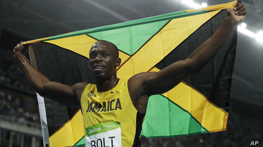 Usain Bolt from Jamaica celebrates after crossing the line to win the gold medal in the men's 200-meter final during the athletics competitions of the 2016 Summer Olympics at the Olympic stadium in Rio de Janeiro, Brazil.