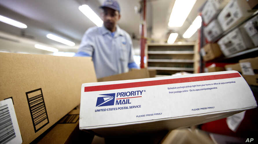 FILE - Packages wait to be sorted in a post office in Atlanta, Feb. 7, 2013.