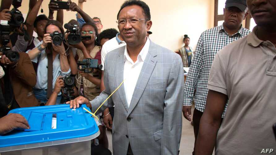 Malagasy presidential candidate and former president Hery Rajaonarimampianina looks on after casting his ballot at the CEG (college d 'enseingnement general) Voting Station at Tsimbazaza, Nov. 7, 2018 in Antananarivo, Madagascar.