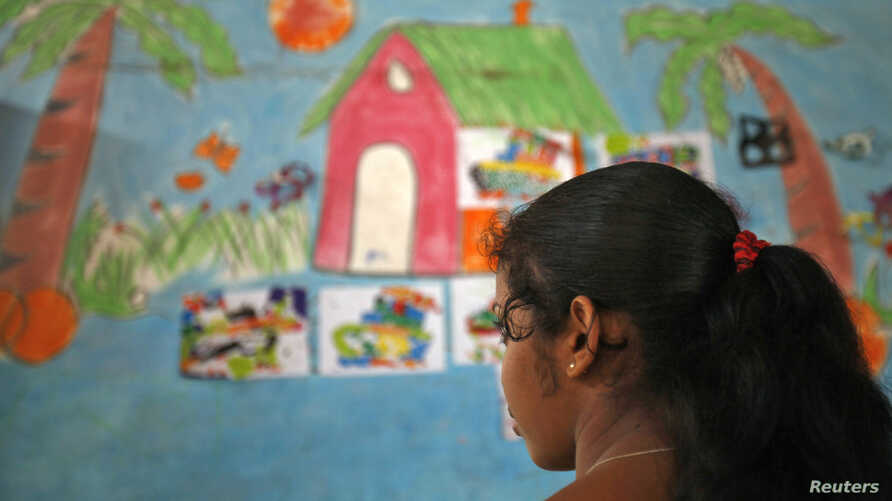 A 16-year-old girl stands inside a protection home on the outskirts of New Delhi, Nov. 9, 2012. She was rescued by Bachpan Bachao Andolan (Save the Childhood Movement), a charity which rescues victims of bonded labor. In the state of West Bengal, pol