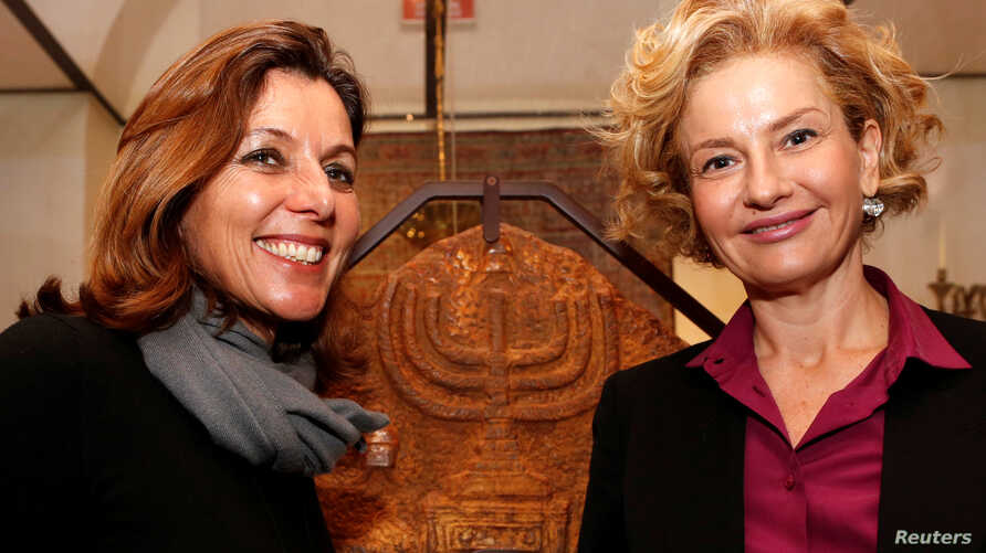 Vatican Museums Director Barbara Jatta, left, and Head of Rome's Jewish Museum Alessandra Di Castro (R) shown during a news conference where they presented an exhibition on the menorah, the ancient symbol of Judaism, at the Jewish Museum in Rome, Feb