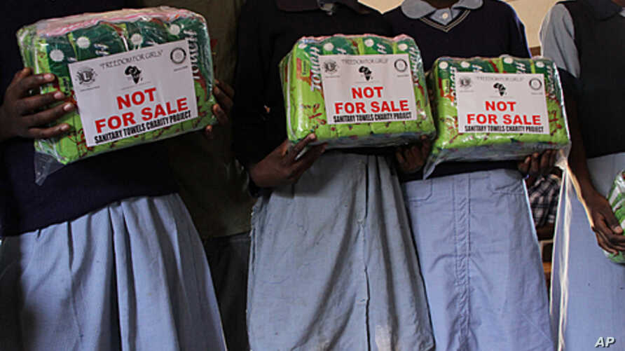 Girls receive a year's worth of sanitary napkins from Freedom for Girls, Mathare slums in Nairobi, Kenya, Feb. 9, 2012.