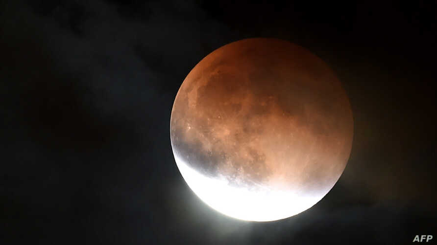 An eclipsed supermoon is shown on September 27, 2015 in Burbank California.