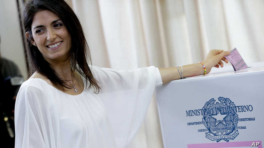Anti-establishment 5-Star Movement (M5S) candidate Virginia Raggi casts her ballot in a polling station in Rome, Italy, June 19, 2016.