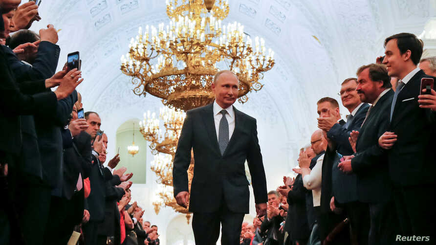 Russian President Vladimir Putin walks before an inauguration ceremony at the Kremlin in Moscow, Russia May 7, 2018.
