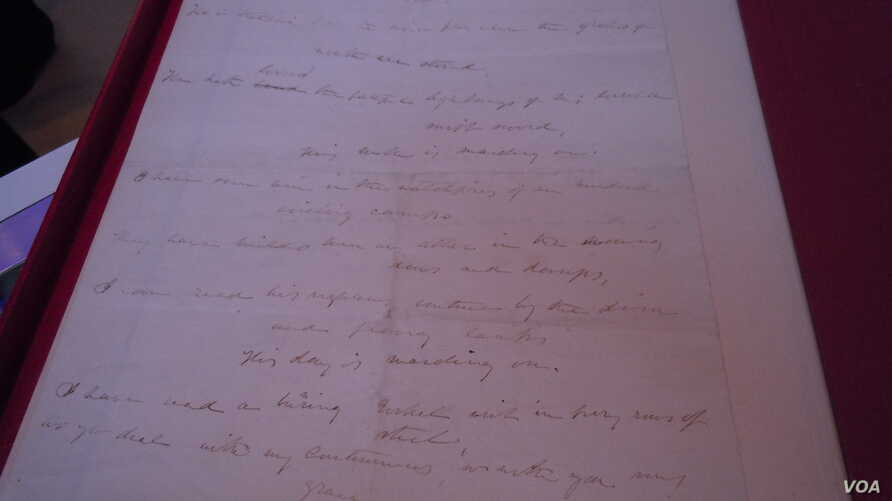 """This original copy of Julia Ward Howe's lyrics for """"Battle Hymn of the Republic"""" is expected to sell for up to $350,000. (VOA/J. Taboh)"""