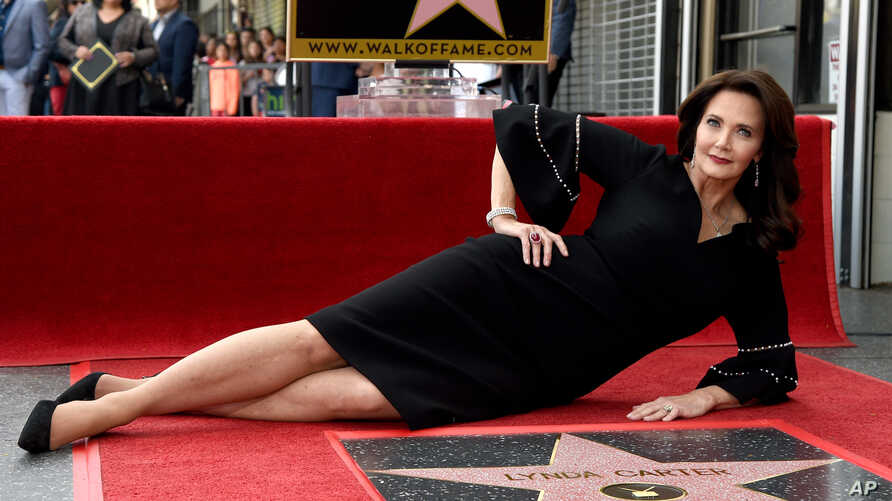 Lynda Carter poses with her star on the Hollywood Walk of Fame following a ceremony on Tuesday, April 3, 2018, in Los Angeles.