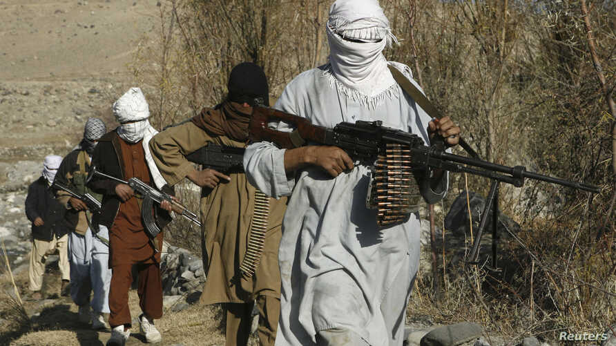 FILE - Armed Taliban fighters are seen at an undisclosed location in Nangarhar province, Afghanistan, Dec.13, 2010. Taliban fighters are currently engaged in clashes with Islamic State militants in the region.