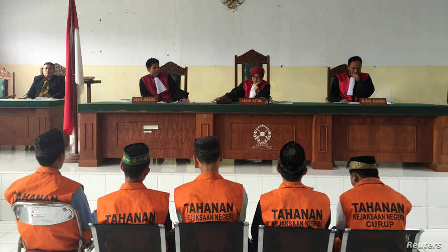 Five men, part of a gang of 14 men and boys, convicted for the rape and murder of a 14-year-old school girl, sit before judges during sentencing in Curup, near Bengkulu, on the island of Sumatra, Indonesia, Sept. 29, 2016.
