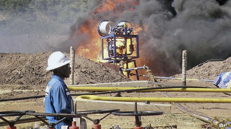 FILE- An oil well undergoes testing in the Lake Albertine region of western Uganda.