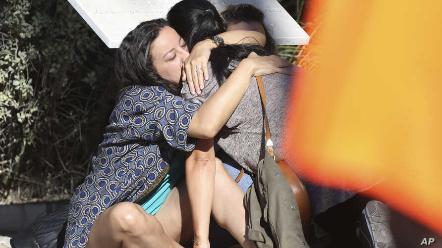 Parents of victims embrace each other near the scene of a truck attack in Nice, France, July 15, 2016.
