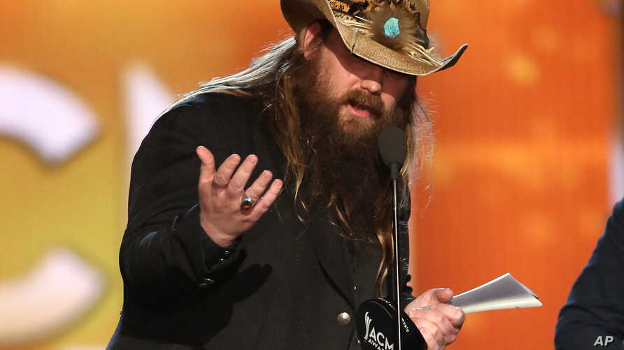 """Chris Stapleton accepts the award for album of the year for """"Traveller"""" at the 51st annual Academy of Country Music Awards at the MGM Grand Garden Arena, April 3, 2016, in Las Vegas."""