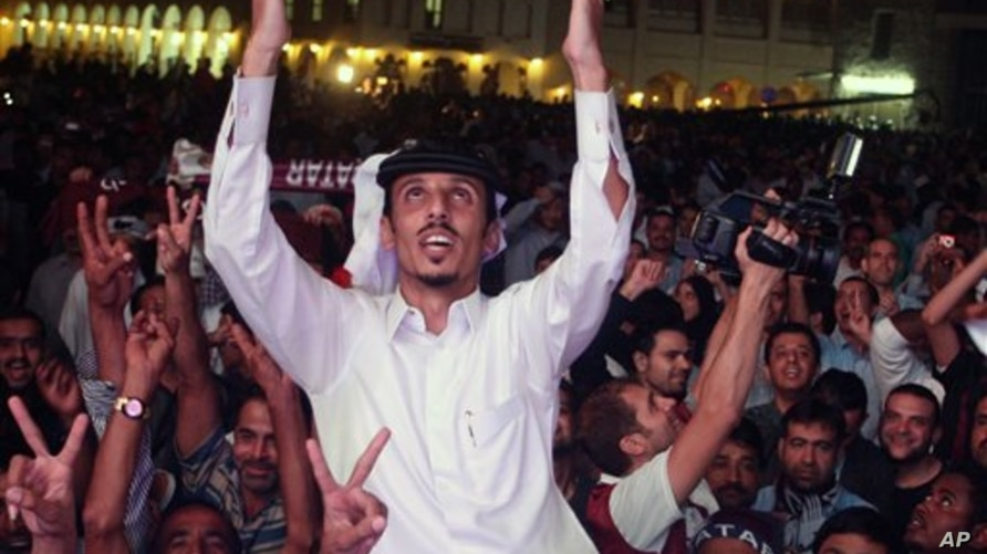 Qataris react in the streets, after the announcement that Qatar will host the soccer World Cup in 2022, in Doha, Dec. 2, 2010.