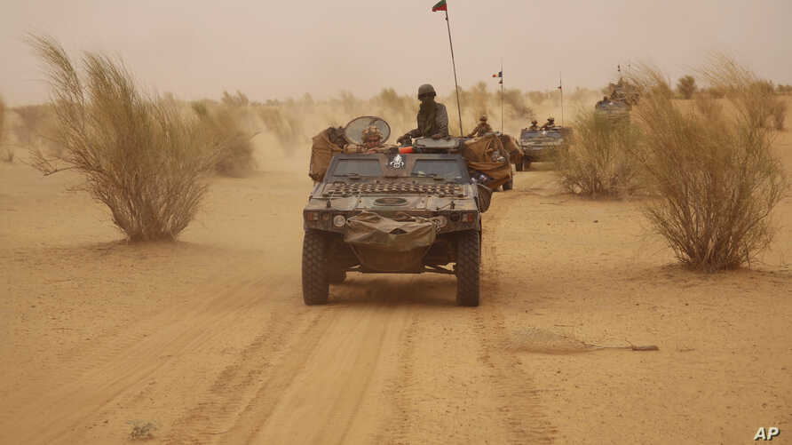 FILE - French forces patrol in the desert of Northern Mali along the border with Niger on the outskirts of Asongo, Northern Mali, June 24, 2015.