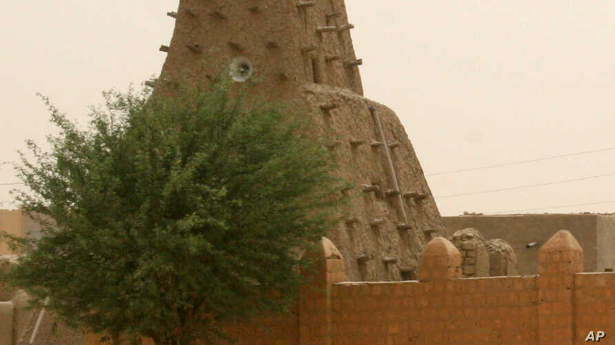 A man walks past the Sankore Mosque, a UNESCO World Heritage Site, in Timbuktu, Mali, April 11, 2012.