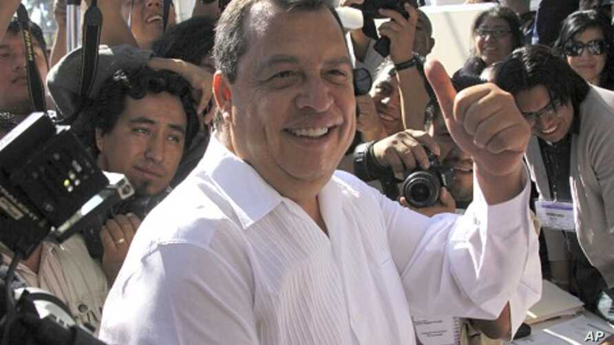 Aguirre gestures before casting his vote in Chilpancingo , January 30, 2011