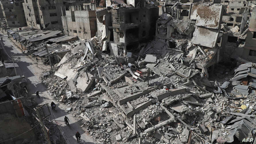 A general view shows several destroyed buildings in Douma, in the rebel enclave of Eastern Ghouta on the outskirts of Damascus, March 5, 2018.