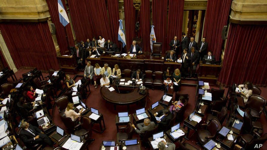 Lawmakers debate a deal with a group of U.S. creditors that would put an end to a years-long dispute that has kept the South American nation on the margins of international credit markets, in Buenos Aires, Argentina, Wednesday, March 30, 2016.