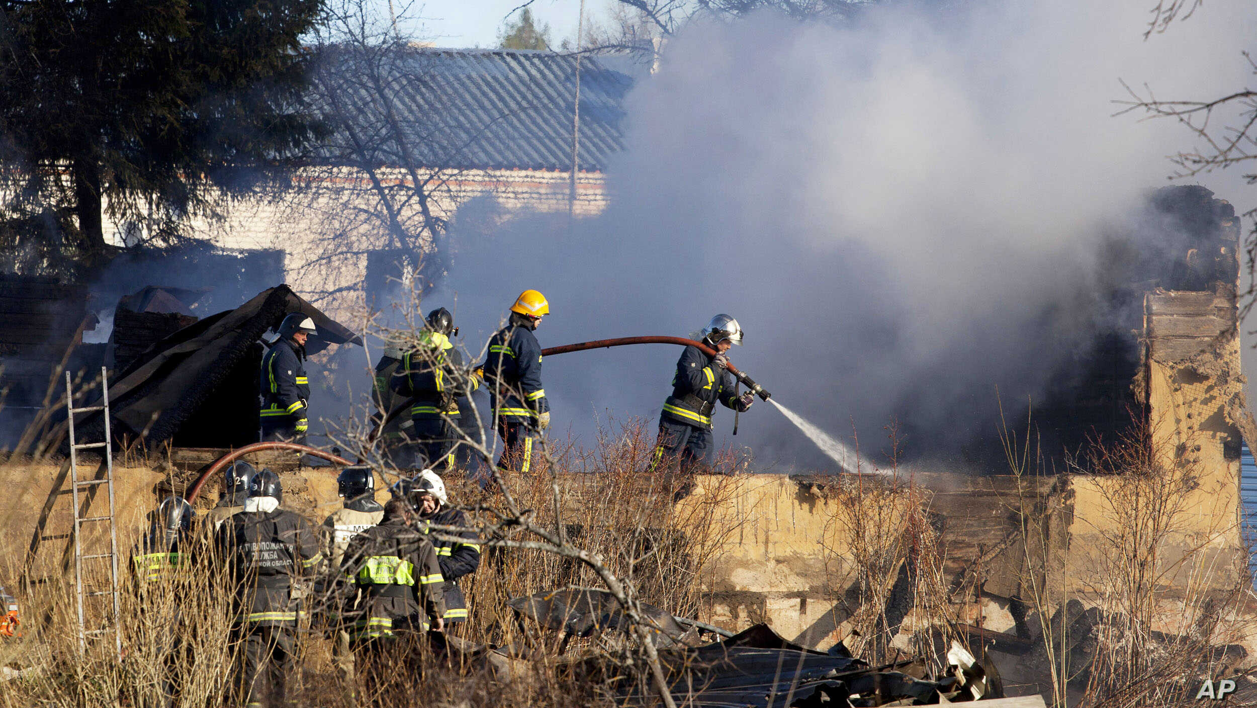 Ministry for Emergency Situations workers and fire fighters work at a site of a fire of a psychiatric hospital, April 26, 2013.