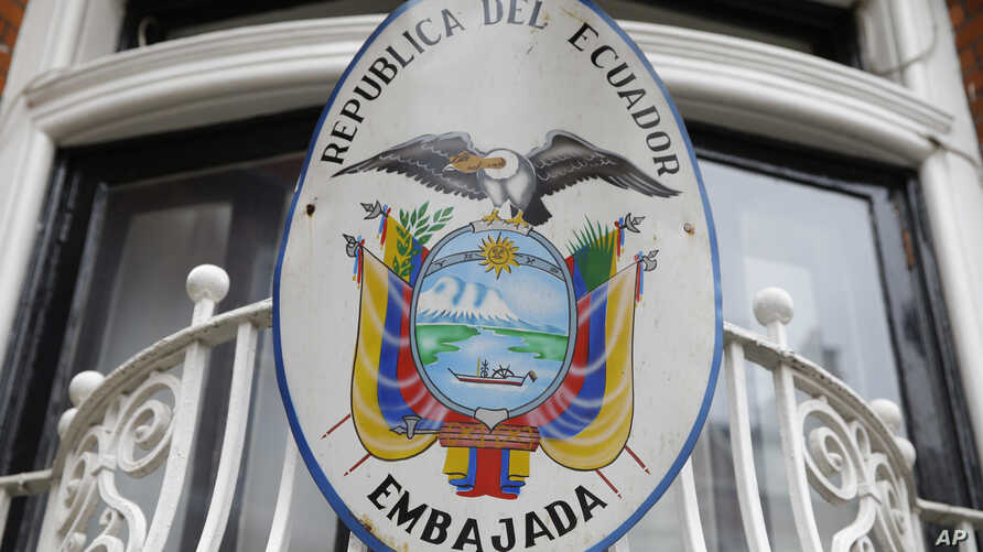 The Ecuadoran national emblem is attached to railings outside the country's embassy in London, Oct. 18, 2016. British officials have long expressed frustration at Ecuador's decision to let WikiLeaks founder Julian Assange take refuge in the embassy.