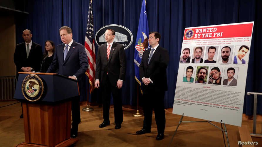 Attorney Geoffrey Berman for the Southern District of New York speaks at a news conference with other law enforcement officials at the Justice Department to announce that nine Iranians have been charged with conducting a massive cybertheft campaign,
