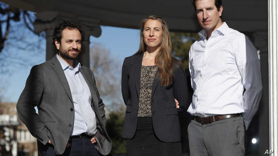 FILE - From left, attorneys David Seligman, Nina DiSalvo and Alexander Hood of Denver's Towards Justice are shown outside the organization's office east of downtown Denver. In a deal filed Wednesday, Jan. 9, 2019, in federal court in Denver, the comp