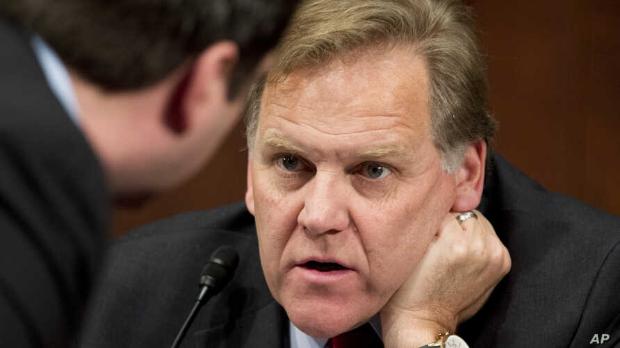 FILE - House Intelligence Committee Chairman Rep. Mike Rogers, R-Mich., right, confers with committee member Rep. Devin Nunes, R-Calif., during their committee's hearing on Capitol Hill about terrorist attacks on U.S. facilities in Benghazi, April ...