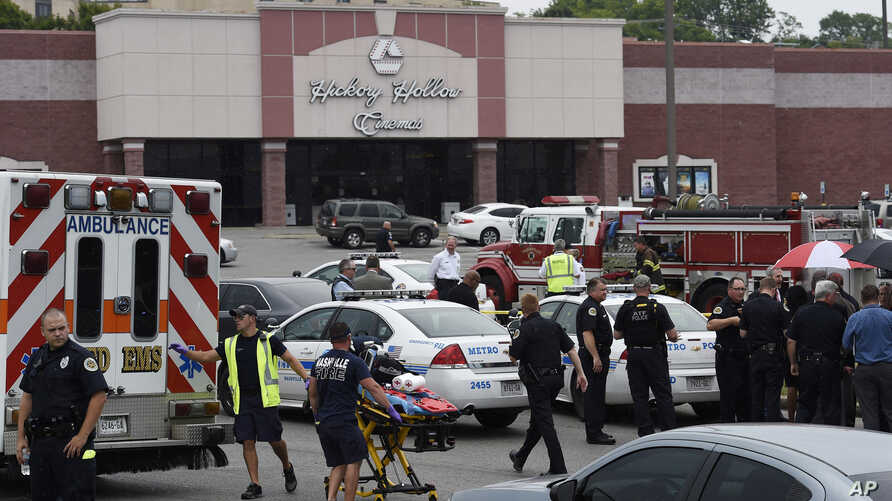 Emergency personnel gather outside Carmike Hickory 8 movie theater following a shooting, in Antioch, near Nashville, Tennessee, August 5, 2015.