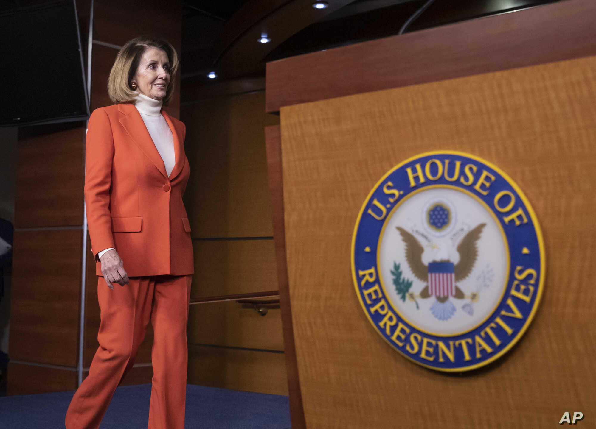 House Minority Leader Nancy Pelosi, D-Calif., arrives to face reporters at a news conference at the Capitol in Washington, Thursday, Nov. 15, 2018.