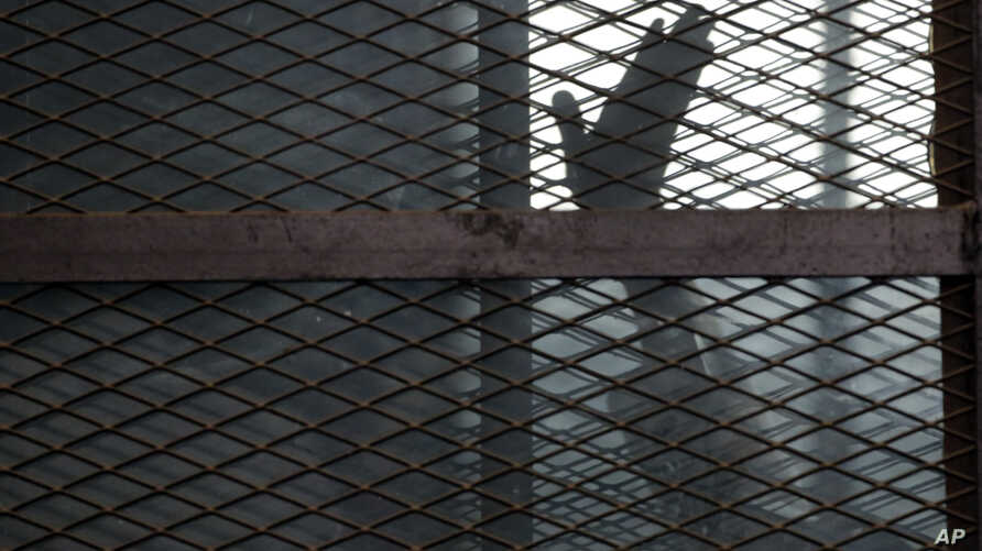 FILE - A defendant is seen caged in a courtroom in Torah prison, southern Cairo, Egypt, Aug. 22, 2015. The U.N. has condemned the recent execution in Egypt of 20 men on alleged terrorist-related charges.