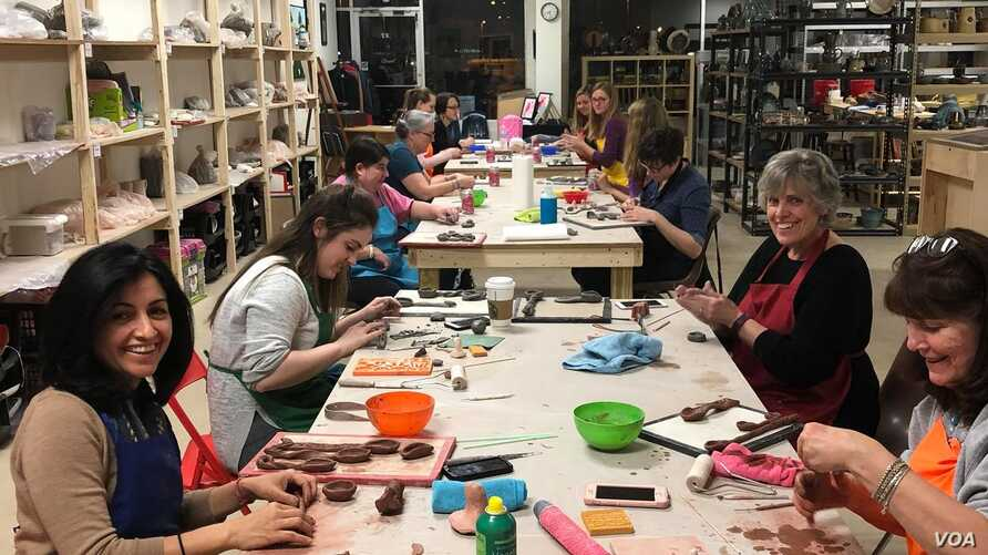 Students get their hands dirty at Clay and Metal Loft's monthly Ladies Night Workshops. (A. Manson)