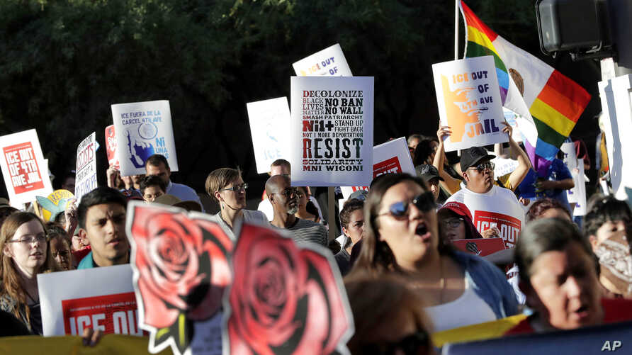 FILE - Protesters march through downtown Phoenix, May 1, 2017. Immigrant and union groups marched in cities across the United States on Monday to mark May Day and protest against President Donald Trump's efforts to boost deportations.
