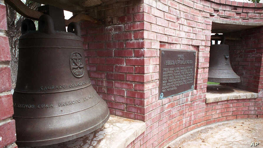 FILE - Two of the bells of Balangiga at F.E. Warren Air Force Base outside Cheyenne, Wyo., shown in May 2001, that signaled an attack by Filipino insurgents on occupying American troops in 1901.
