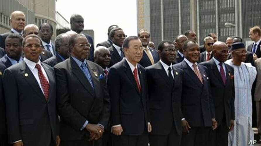 Malawi President and president of African Union Bingu wa Mutharika, front second left, stands with UN Secretary General Ban Ki-moon, as they pose for a group photo with other African heads of states at the AU summit in Addis Ababa, Ethiopia, January