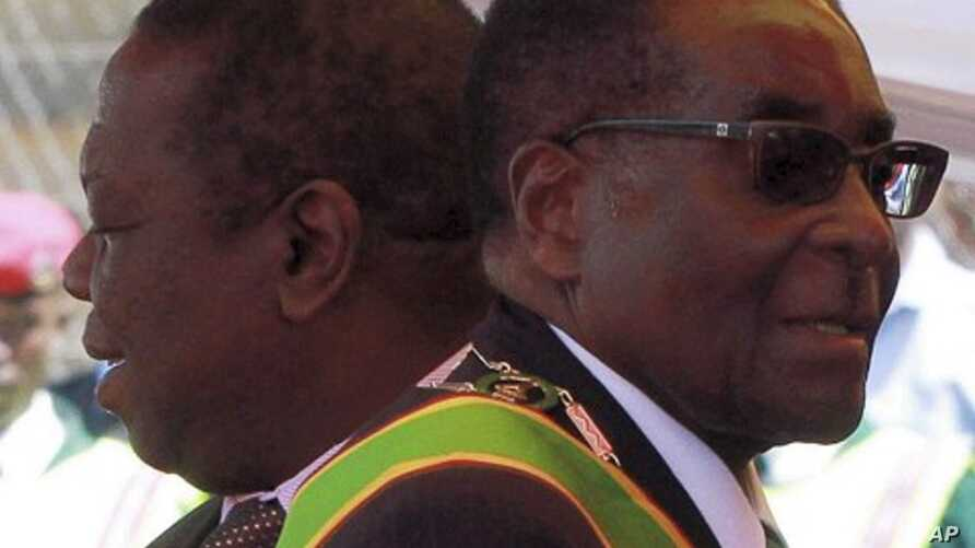 Zimbabwean President Robert Mugabe (R) and Prime Minister Morgan Tsvangirai arrive at a rally marking Zimbabwe's 31st independence anniversary celebrations in Harare (File Photo - April 18, 2011)