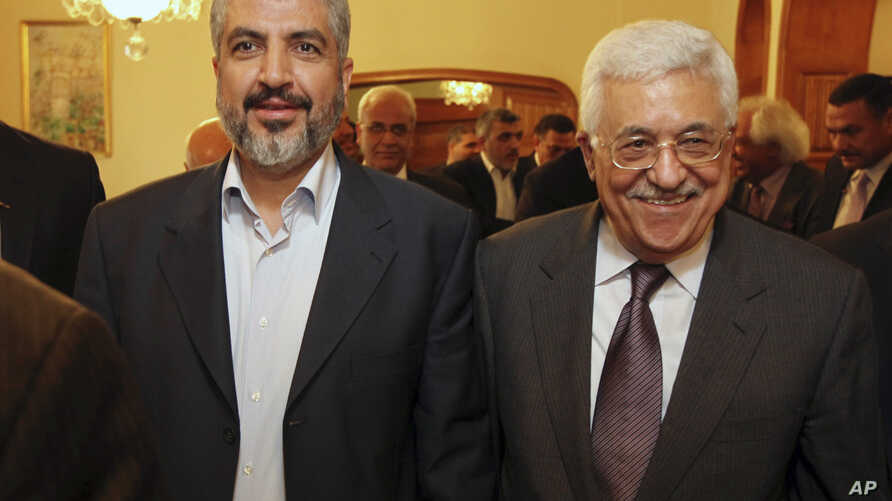 In this photo provided Nov. 24, 2011 by the office of Khaled Meshaal, Palestinian Hamas leader Khaled Mashaal, left, and Palestinian President Mahmoud Abbas are seen together during a meeting in Cairo, Egypt.